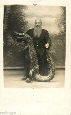 Jacksonville, FLORIDA-Bearded Man with Alligator in Studio Setting c1910 RPPC FL | eBay