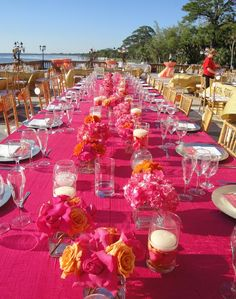 Love the centerpieces and the glasses with the petals underneath the floating candles.