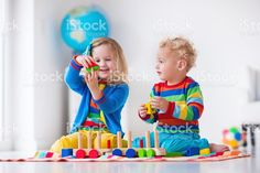 Kids playing with wooden toy train royalty-free stock photo