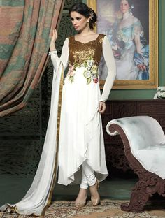 Stay ahead of the current trend just by stepping out in this breathtaking white and golden designer salwar suit. #Shopnow