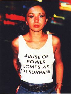 Graffiti artist Lady Pink wearing a t-shirt by Jenny Holzer in 1983