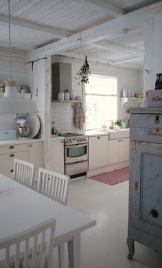 White kitchen.  Note that dishwasher has a matching cabinetry front.