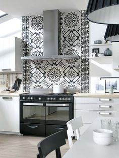 This patterned tile is the focal point in this white kitchen | Cool on kitchen garden ideas, light kitchen ideas, steel kitchen ideas, brick kitchen ideas, red kitchen ideas, hardwood kitchen ideas, vinyl kitchen ideas, air conditioning ideas, cement kitchen ideas, tiled kitchen islands, tiled kitchen floor, tiled kitchen countertops, tiled kitchen cabinets, vaulted ceilings ideas, decorating kitchen ideas, tiled living rooms, glass kitchen ideas, square kitchen ideas, wall kitchen ideas, tiled kitchen sinks,