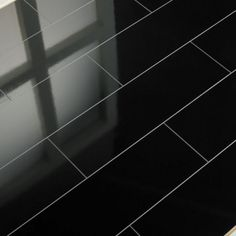 Elesgo Supergloss Black Micro V5 Groove Laminate Flooring - Supergloss High Gloss Laminate Flooring, Massive Range Online, Full Range of Colours. Buy Today At Lowest Online Prices. Brand New Popular Contemporary Flooring