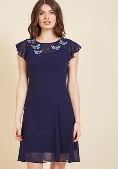 <p>With its collection of blue butterfly appliques fluttering atop navy chiffon fabric, this sweet shift dress from our ModCloth namesake label holds the promise of a stylish day ahead! Further finessed with ruffled cap sleeves and a satiny slip, this keyhole-closed number isn't a pretty probability - it's a gorgeous guarantee.</p>