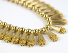 1960's Egyptian style Collar Necklace | From a unique collection of vintage beaded necklaces at http://www.1stdibs.com/jewelry/necklaces/beaded-necklaces/