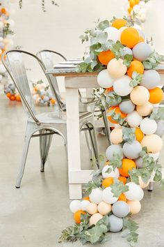 Balloon Installations As Wedding Decor ~ balloon garland as table runner for a sweetheart table idea by Foxes Events