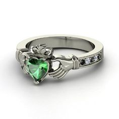 My dream claddagh ring! Emerald with diamonds and black diamonds on side!