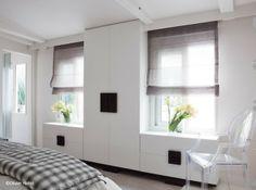 meubles de rangement sur-mesure autour des fenêtres