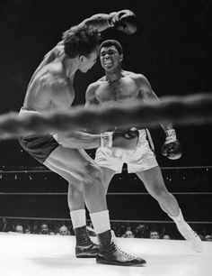 Cleveland Williams drops to the canvas for the second time in Round 2 after Muhammad Ali hit him with a left-right combination during their fight in the Astrodome on Nov. 14, 1966. Ali retained his heavyweight title with a third-round TKO. (AP Photo)