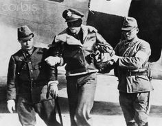 Captured American Airman - HU017017 - Rights Managed - Stock Photo - Corbis. A blindfolded American military pilot is escorted from a plane, possibly to his own execution, by two Japanese soldiers. The unidentified pilot may have been taken prisoner during the 1942 Doolittle raids over Tokyo. The Japanese declared that any pilot shot down over Japan during this raid would be executed.