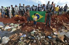 That stark contrast in those two worlds can be seen a picture taken by British writer Michael Calvin, which shows a group of people wearing Brazil jerseys throwing bottles and other rubbish into a trash bin that (unknown to the fans) had somoeone sitting inside it.