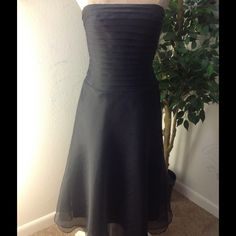Black dress gown bridesmaid prom Gorgeous elegant and very classy short black strapless evening dress / gown. Pleated bust. Very clean and in excellent condition. Will steam before shipping to reduce wrinkles. Bari Jay Dresses