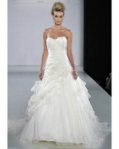 {Ian Stuart wedding gown} Ruched bodice with soft wispy tulle skirt