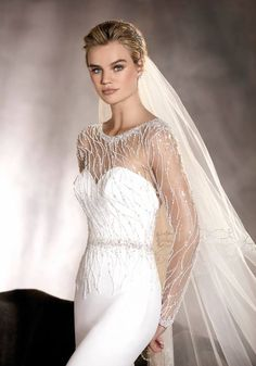 Pronovias | A long sleeves wedding gown with beaded detailing.