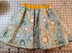 Paisley skirt with white lace overlay and contrasting waistband.  Child Size 5/6