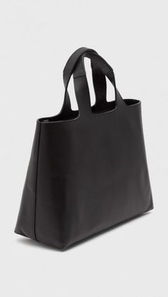 MINIMAL + CLASSIC: Robert Clergerie Viagoj Raw Tote in Black | The Dreslyn