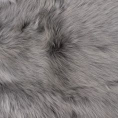 """Intensely soft and excitingly flexible, this suede-backed Toscana lamb fur is of a remarkable quality. Faced with up to 1"""" long, fluffy, luminous hairs, this high-quality fur consists of a superb hand you will never want to let go of. On the back side of this material lays an unbelievably soft and bendable suede. Of a medium weight and in a powdered blue coloration, this fur hide would be ideal when creating rich outerwear as well as fabulous accessories. Keep in mind this type of small…"""