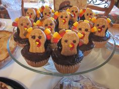 Turkey Cupcakes- for peanut allergies use a milano cookie instead of a butter butter, can use Swedish fish instead of candy corn- it looks cute