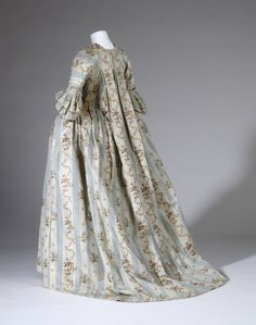 Back view, robe à la francaise, c. 1780. Pale blue and cream striped silk, decorated with floral festoons, lined with linen.
