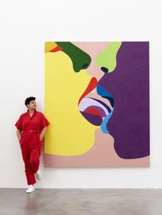"""Helen Beard with one of her paintings in the """"True Colours"""" exhibition at Damien Hirst's Newport Street Gallery. Photo courtesy of the Newport Street Gallery."""