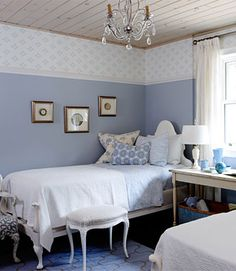 A blue bedroom with a chandelier accent. Designed by Sarah Richardson, Interior Designer & TV host. See how she does it here: http://www.lowes.ca/articles/never-stop-improving-with-sarah-richardson---episode-10_a1153.html?linkloc=PDIY