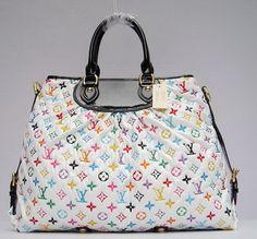 LV Handbag. Gathers at top tab. Neat.