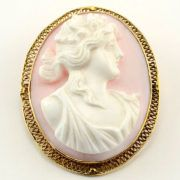 Antique French gold framed carved white coral cameo pin or pendant, circa 1880. This cameo has an open work 14 karat yellow gold frame and depicts a woman