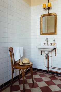 French Country Bathroom in bathroom ideas, white tiled bathroom with checkerboard tiled floor, traditional sink and fittings, antique gold vanity mirror.