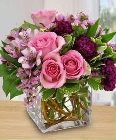 Centerpiece flower arrangements bouquets pinterest small square vase stems cut short on flowers and as many as possible inserted into vase mightylinksfo