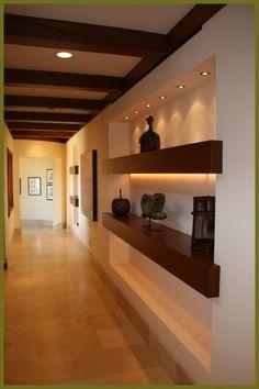 Back-lit shelves and  wood beams