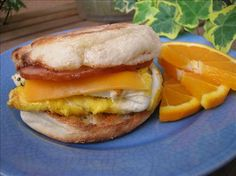 "Egg McMuffin Copycat - Microwave tip from dingobully: ""Microwave the egg in a small flat bowl sprayed with cooking oil for one minute while the muffin is toasting. Then an extra 30 seconds with the Canadian bacon and cheese on top. The muffin will be done now and the egg pops right out onto it!"""