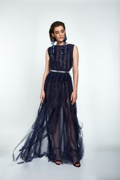 Two-piece eveningwear, with a floor length skirt and sleeveless top,  can be styled with or without a leather belt. The deep blue silk organza is handmade tampered, the fabric manipulation gives the elegant and clean line a distinctive drama feel when walked in. Seemingly feminine easy fit makes it for comfortable wear even in the most demanding of sets. #viktoriavarga #viktoriavargabudapest #designer #hungariandesigner #handmade #ootd #outfit #blue #dress #organza #silk Ball Skirt, Silk Organza, Fabric Manipulation, Signature Collection, Deep Blue, Wedding Gowns, Evening Dresses, Drama, Feminine