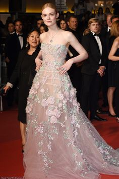 2016 Cannes Film Festival: The young actress wearing a stunning Zuhair Murad strapless gown embellished with pink roses