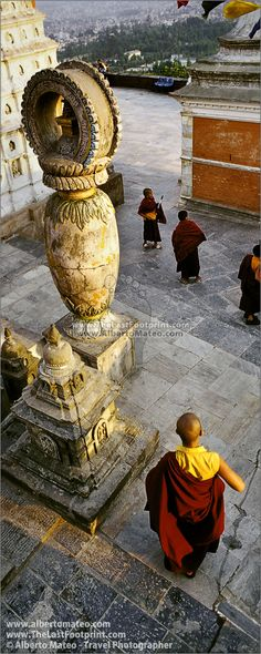 Buddist Monks in Swayambunath Stupa, Kathmandu, Nepal. Photograph by Alberto Mateo, Travel Photographer.