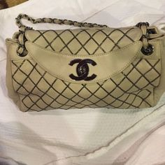 Chanel lamb skin and silver hardware bag Guaranteed authentic Chanel bone colored & silver hardware back. Please view pics and ask all questions prior to...inside of bag has make up stains CHANEL Bags