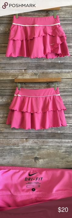Nike dri fit pink tennis skort Nike dri-fit pink tennis skirt with built in shorts (skort). Super cute and great condition. Waist measures about 13 inches across lying flat and has elastic in it, about 11 inches in length. Size Small. Nike Skirts