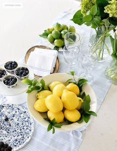 CASUAL AND RUSTIC BLUE AND WHITE TABLESCAPE Create a welcoming tablescape of blue and white accented with fresh flowers, lemons and limes.Create a welcoming tablescape of blue and white accented with fresh flowers, lemons and limes. Color Limon, Table Centerpieces, Table Decorations, Brunch Table, Home Decor Hacks, Decor Ideas, Gift Ideas, Rustic Frames, Rustic Blue