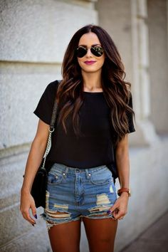 A black crew-neck tee and blue distressed denim shorts feel perfectly suited for weekend activities of all kinds.   Shop this look on Lookastic: https://lookastic.com/women/looks/black-crew-neck-t-shirt-blue-shorts-black-crossbody-bag/17342   — Black Crew-neck T-shirt  — Black Leather Crossbody Bag  — Blue Ripped Denim Shorts  — Black Sunglasses
