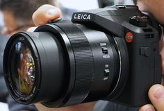 The Leica D-Lux is a deluxe version of the LX100, which squeezes a powerful Micro Four Thirds sensor into a surprisingly compact body. | #Leica #Photokina2014 #Panasonic #cameras #photography