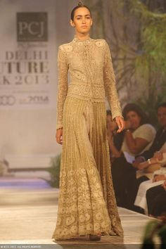 Tamara Moss walks the ramp for designer Anamika Khanna on Day 2 of Delhi Couture Week, held in New Delhi, on August 01, 2013.