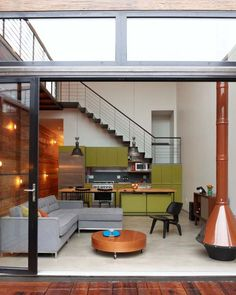 Open plan living room and dining room and kitchen. I like the Copper Brown Wall color and the Organic Olive Green.