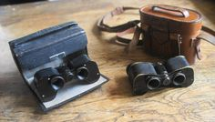 """Ross London """"Deatron"""".3X13 Opera Prism Binoculars. Serial number 29347. Year 1910. Serial number 29075. Year 1910 Different bags The same body were 15 years later the carrier of a 6X Ross """"Vest Pocket"""" binocular. In the 20's small binoculars was very popular for various use, motor race, boating, horse races. These two very small binoculars one for the Opera and one for the Races, don't display as luxery items. But prism binoculars never was cheap."""