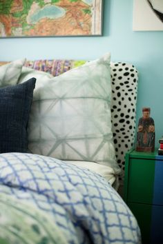 There are so many mixed textiles in this room, it's layering to the max. The duvet is Roberta Roller Rabbit. Shibori pillows by Rebecca Atwood. Throw pillows from Furbish Studio. I made the headboard myself.