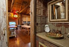 The bathroom in the Smokehouse features a vintage tin ceiling tile backsplash among reclaimed lumber and building materials used to construct the space.
