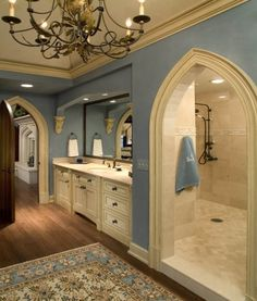 Im not a big fan of blue, but I love this bathroom!!  Shower behind the sinks = amazing!! Light fixture, the doorways....the cabinetry.. floors! Love it!