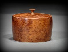 Redwood Burl treasure box with Mesquite pull, by New England woodturner Ray Asselin. At Bowlwood.com.