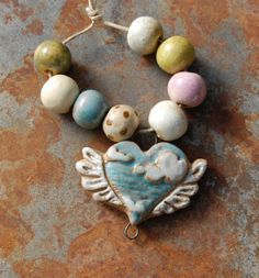 These hand picked, earth and love tone, artisan made ceramic beads are hand formed, hand carved and an original design!