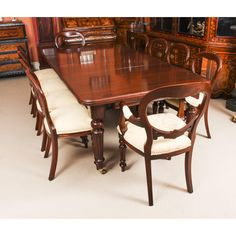 A magnificent antique Victorian solid mahogany wind out dining table and ten balloon back dining chairs. Buy Dining Table, Mahogany Dining Table, Dining Chairs, Dining Room, Piano Stool, Chair Height, Table And Chair Sets, Brown Wood, Furniture Making