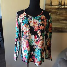 Pretty size medium floral blouse This pretty floral top has lace detail on shoulders and around neck. Never worn and needs some love! 100% rayon. Soft, thin, and silky. Smoke free home. Bundles are 15% off and I ship fast. Copper Key Tops Blouses